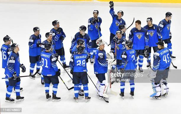 Finland's players celebrate winning the IIHF Men's Ice Hockey World Championships quarterfinal match between Finland and Sweden on May 23 2019 at the...