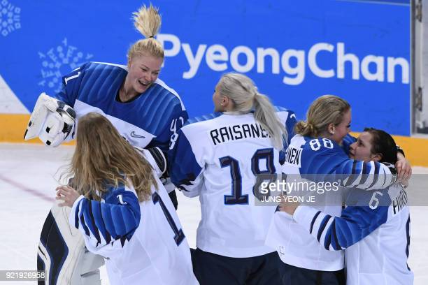 Finland's players celebrate winning the women's bronze medal ice hockey match between Finland and the Olympic Athletes from Russia during the...