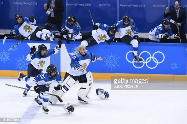 TOPSHOT Finland's players celebrate winning the women's bronze medal ice hockey match between Finland and the Olympic Athletes from Russia during the...