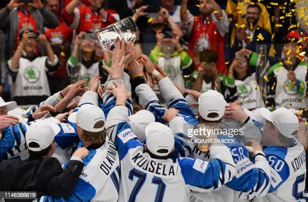 TOPSHOT Finland's players celebrate with the trophy after the IIHF Men's Ice Hockey World Championships final between Canada and Finland on May 26...