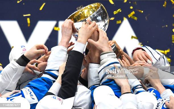 Finland's players celebrate with the trophy as they win during the IIHF Men's Ice Hockey World Championships final between Canada and Finland on May...