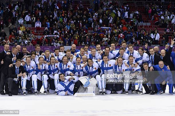 Finland's players celebrate with their medals after winning the Men's ice hockey Bronze Medal Game USA vs Finland at the Bolshoy Ice Dome during the...
