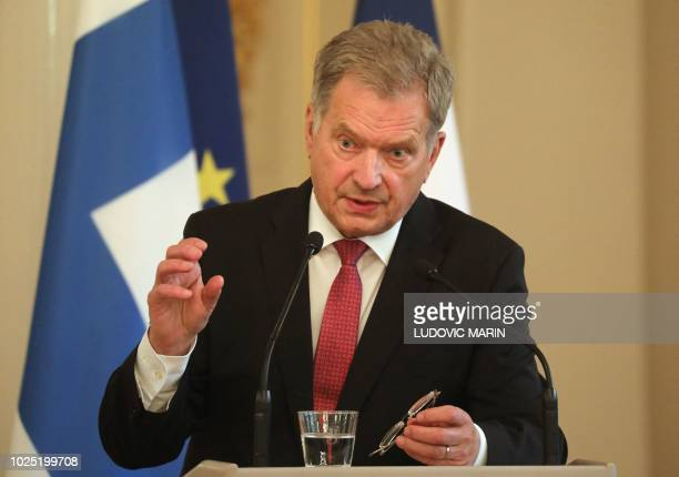Finland's President Sauli Niinistö addresses a press conference with France's President after their meeting at the Presidential Palace in Helsinki on...