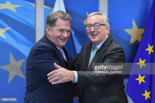 Finland's President Sauli Niinisto is welcomed by European Commission President JeanClaude Juncker at the European Commission in Brussels on March 28...