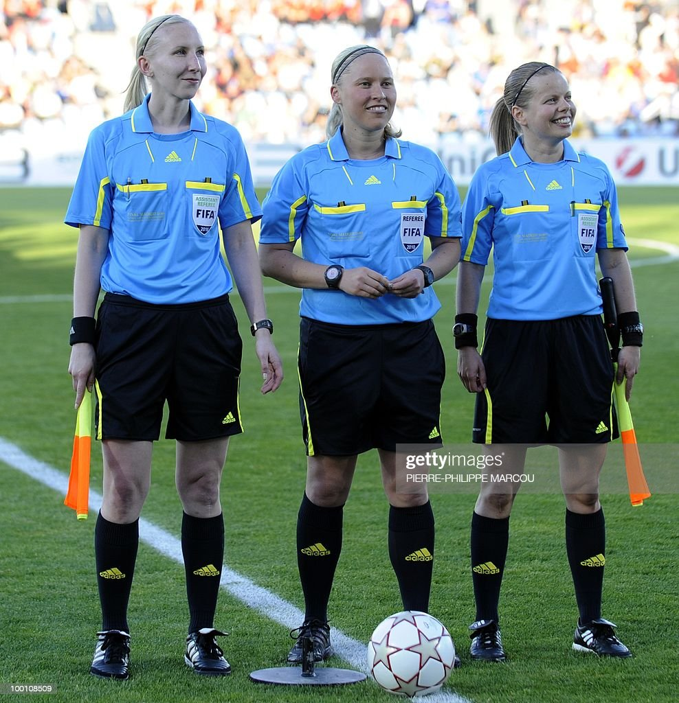 Finland's referee Kirsi Heikkinen (C) poses with compatriots Tonja Paavola (R) and Anu Jokela during the UEFA women's final Champions League football match between FFC Turbine Potsdam and Olympique Lyonnais at Coliseum Alfonso Pérez on May 20, 2010 in Getafe.