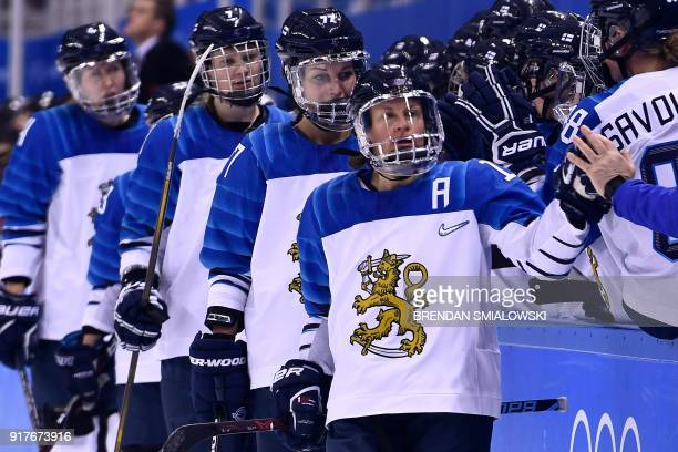 Finland's Riikka Valila celebrates with teammates after scoring a goal during the final period of the women's preliminary round ice hockey match...