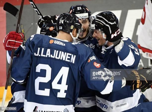 Finland's Sakari Manninen Jani Lajunen Jesse Virtanen and Mika Pyorala celebrate Manninen's 11 goal during the Ice Hockey Euro Hockey Tour Karjala...