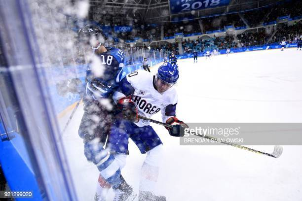 Finland's Sami Lepisto and South Korea's Michael Swift clash in the men's playoffs qualifications ice hockey match between Finland and South Korea...