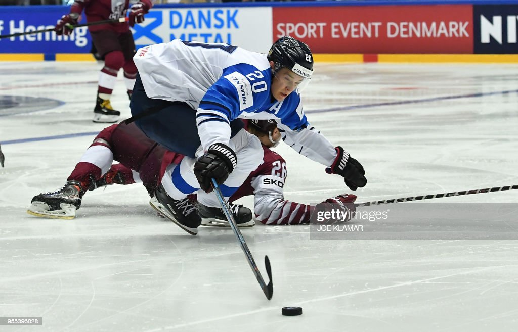 Finland's Sebastian Aho (top) fights for the puck with Latvia's Uvis Baliskis during the group B match Latvia vs Finland of the 2018 IIHF Ice Hockey World Championship at the Jyske Bank Boxen in Herning, Denmark, on May 6, 2018.