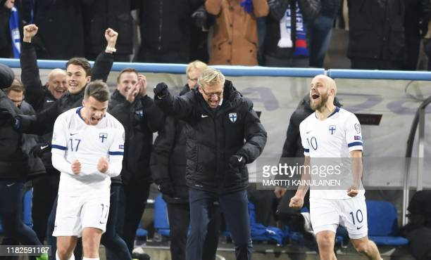 Finland's Simon Skrabb , Finland 's head coach Markku Kanerva and Finland's Teemu Pukki celebrate with the rest of the team at the end of the UEFA...