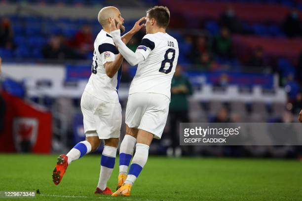 Finland's striker Teemu Pukki celebrates with Finland's midfielder Robin Lod after scoring their first goal during the UEFA Nations League group B4...