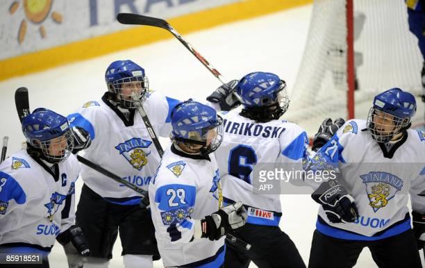 Finland's Suomen Emma Laaksonen , Marjo Voutilainen , Karoliina Rantamäki , Jenni Hiirikoski and Michelle Karvinen celebrates team's opening goal...