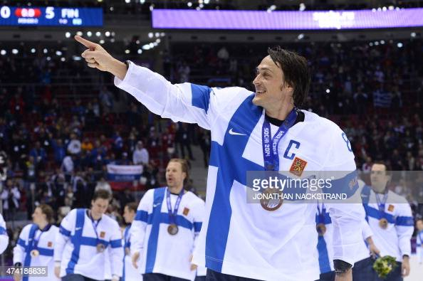 Finland's Teemu Selanne and teammates celebrate after winning the Men's ice hockey Bronze Medal Game USA vs Finland at the Bolshoy Ice Dome during...