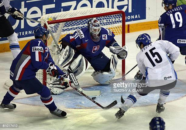 Finland's Tuomo Ruutu shoots on Slovakia's Peter Budaj during the preliminary round of the 2008 IIHF World Hockey Championships at the Halifax Metro...