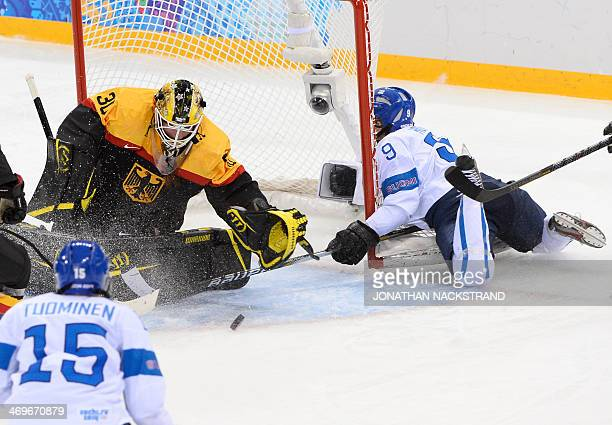 Finland's Venla Hovi collapses into the net in front of Germany's Andrea Lanzl and goalkeeper Jennifer Harss during the Women's Ice Hockey 5th 8th...