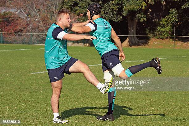 Finlay Bealham and Ultan Dillane stretching during the Irish national rugby team training session at Westerford High School fields on June 07, 2016...