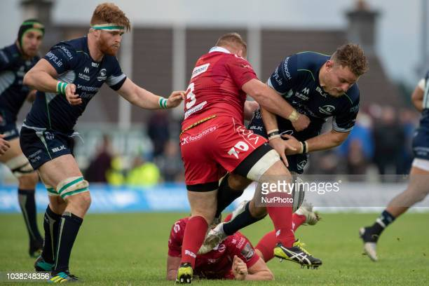 Finlay Bealham of Connacht tackled by Samson Lee of Scarlets during the Guinness PRO14 match between Connacht Rugby and Scarlets at the Sportsground...