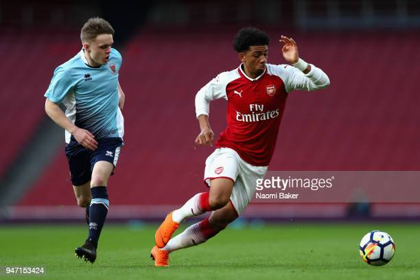 Finlay SinclairSmith of Blackpool and Xavier Amaechi of Arsenal chase after the ball during the FA Youth Cup Semi Final 2nd Leg match between Arsenal...