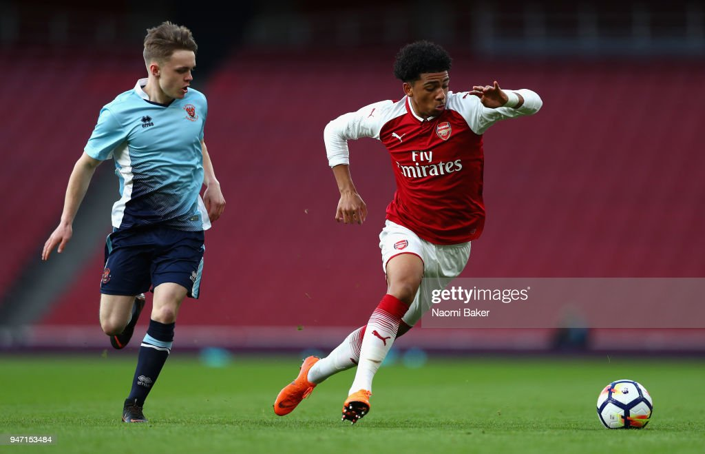 Finlay Sinclair-Smith of Blackpool and Xavier Amaechi of Arsenal chase after the ball during the FA Youth Cup Semi Final 2nd Leg match between Arsenal and Blackpool at Emirates Stadium on April 16, 2018 in London, England.