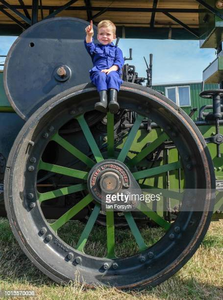 Finley Borthwick from Houghton Le Spring sits on the wheel of a 1926 steam locomotive called 'Ayesha' during the final day of the Whitby Traction...