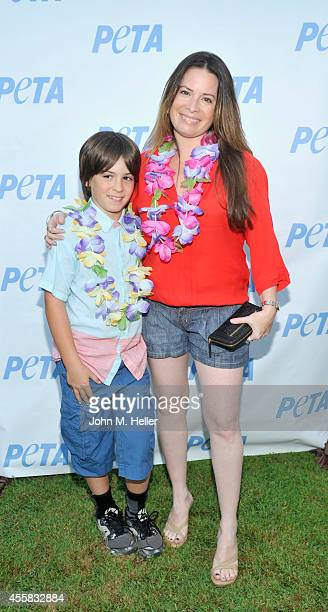 Finley Donoho and actress Holly Marie Combs attend PETA's Vegan Luau at Sam Simon's home on September 20 2014 in Pacific Palisades California