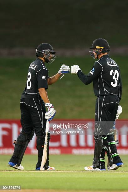 Finn Allen and Jakob Bhula of New Zealand bump fists during the ICC U19 Cricket World Cup match between New Zealand and the West Indies at Bay Oval...