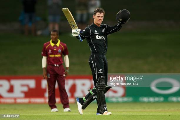 Finn Allen of New Zealand celebrates his century during the ICC U19 Cricket World Cup match between New Zealand and the West Indies at Bay Oval on...