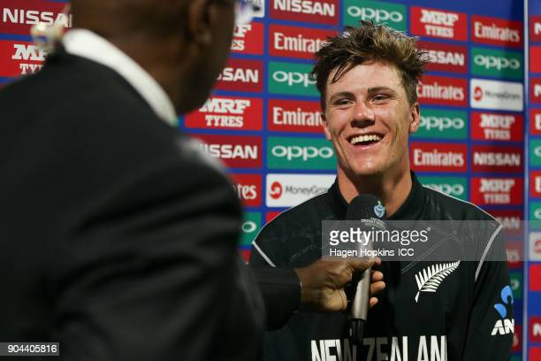 Finn Allen of New Zealand is interviewed by former West Indies cricketer Ian Bishop during the ICC U19 Cricket World Cup match between New Zealand...