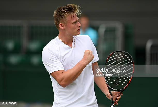 Finn Bass of Great britain celebrates during the Boy's singles first round match against Marvin Moeller of Germany on Middle Sunday of the Wimbledon...