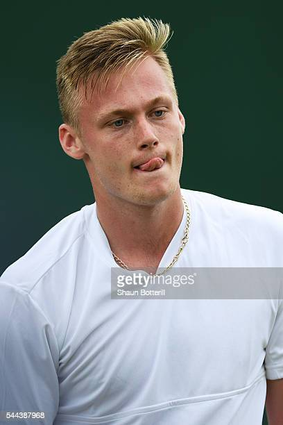 Finn Bass of Great Britain looks on during the Boy's singles first round match against Marvin Moeller of Germany on Middle Sunday of the Wimbledon...