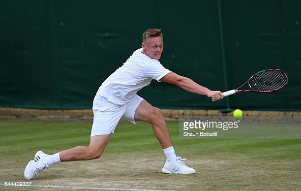 Finn Bass of Great britain plays a backhand during the Boy's singles first round match against Marvin Moeller of Germany on Middle Sunday of the...