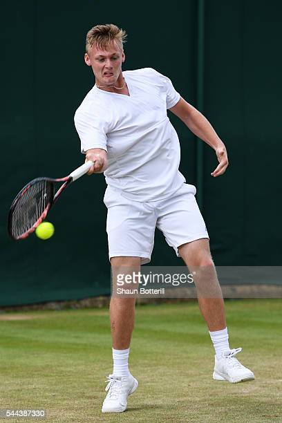 Finn Bass of Great britain plays a forehand during the Boy's singles first round match against Marvin Moeller of Germany on Middle Sunday of the...