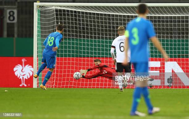 Finn Dahmen of Germany saves a penalty of Zan Celar of Slovenia during the international friendly match between Germany U21 and Slovenia U21 at...