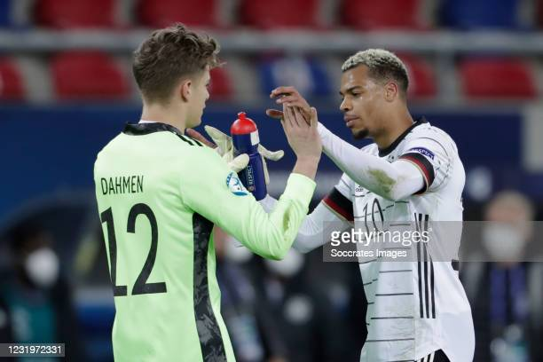 Finn Dahmen of Germany U21, Lukas Nmecha of Germany U21 during the EURO U21 match between Germany v Holland at the Sosto Arena on March 27, 2021 in...