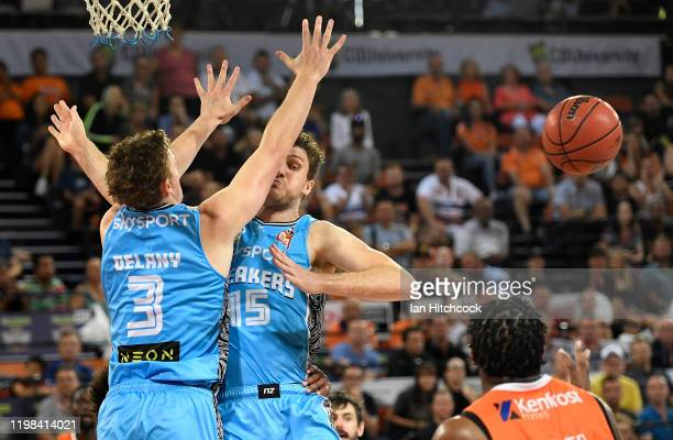 Finn Delany and Rob Loe of the Breakers block the shot of Cameron Oliver of the Taipans during the round 15 NBL match between the Cairns Taipans and...