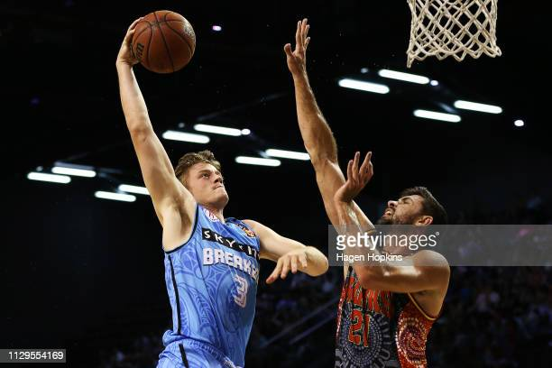 Finn Delany of the Breakers attempts to beat the challenge of Todd Blanchfield of the Hawks during the round 18 NBL match between the New Zealand...