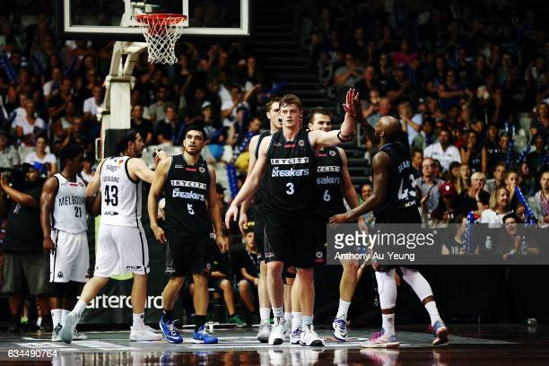 Finn Delany of the Breakers celebrates with teammates after drawing a foul during the round 19 NBL match between the New Zealand Breakers and...