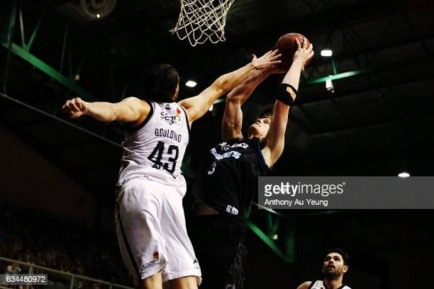 Finn Delany of the Breakers goes up against Chris Goulding of United during the round 19 NBL match between the New Zealand Breakers and Melbourne...