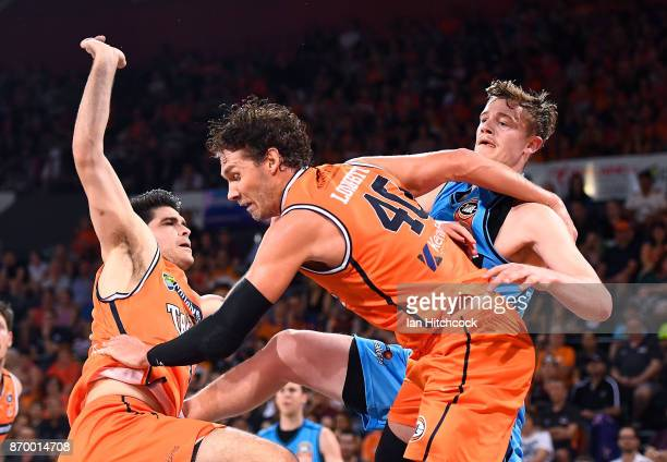 Finn Delany of the Breakers passes the ball under the basket during the round five NBL match between the Cairns Taipans and the New Zealand Breakers...