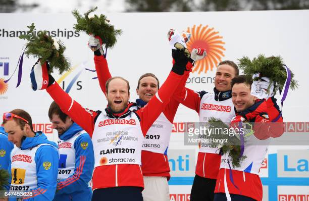 Finn Haagen Krogh Didrik Toenseth Niklas Dyrhaug and Martin Johnsrud Sundby of Norway celebrate winning the gold medal in the flower ceremony for the...