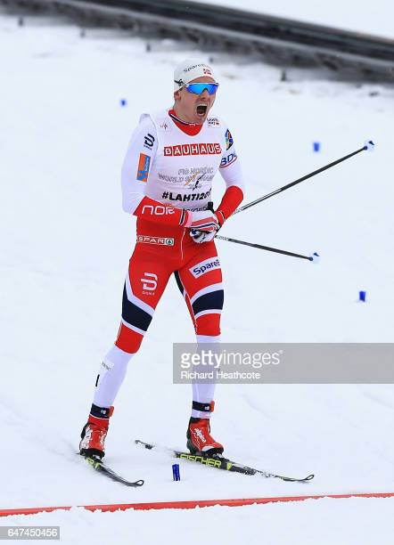 Finn Haagen Krogh of Norway celebrates winning the gold medal in the Men's 4x10km Cross Country Relay during the FIS Nordic World Ski Championships...