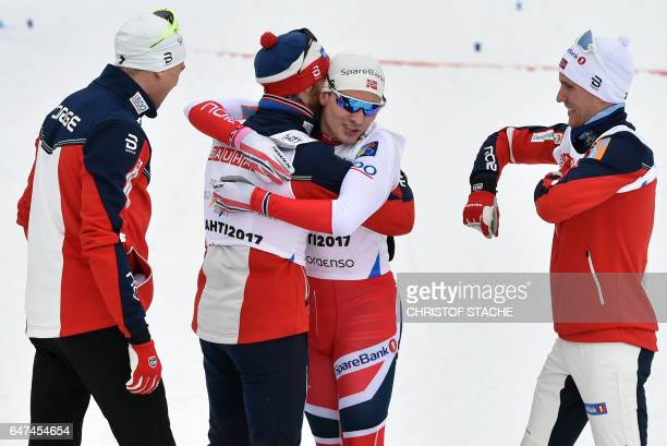 Finn Haagen Krogh of Norway's men's relay team celebrates with his teammates after crossing the finish line to win with his teammates the men's...
