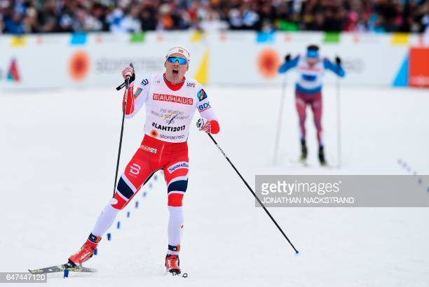 Finn Haagen Krogh of Norway's men's relay team crosses the finish line to win with his teammates the men's cross-country 4x10 km relay event of the...