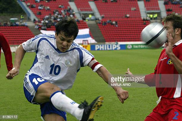 Finn Jari Litmanen and Andorran Josep Manuel Ayala vie as Finland blanked Andorra 30 in a World Cup 2006 2006 FIFA World Cup qualifying round match...