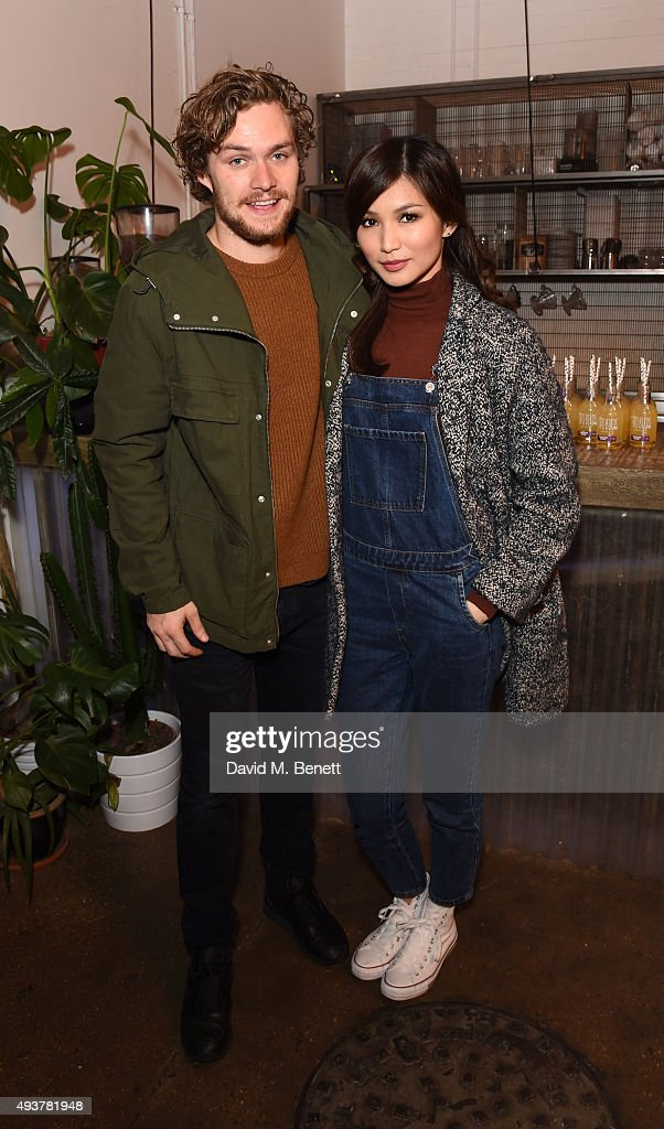 Finn Jones (L) and Gemma Chan attends Whistles Men 1st birthday celebrations at Protein Galleries on October 22, 2015 in London, England.