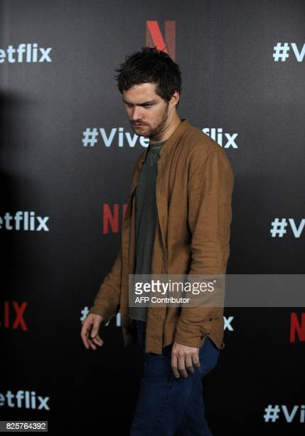 """Finn Jones from the cast of Marvel's """"The Defenders"""" poses for photographs during a Netflix Red Carpet #ViveNetflix in Mexico City, on August 02,..."""