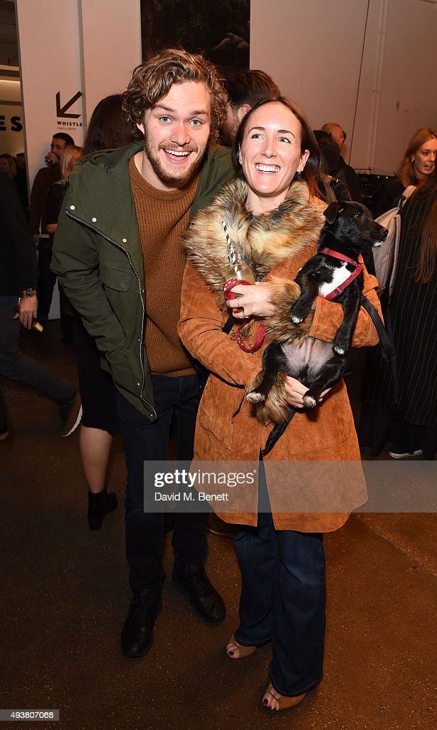 Finn Jones (L), Guest and Huxley The Dog attend Whistles Men 1st birthday celebrations>> at Protein Galleries on October 22, 2015 in London, England.