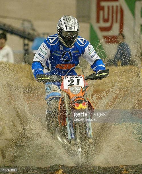 Finn Juha Salminen rides a KTM Motorbike during the VI Enduro Indoor International in Barcelona's Palau Sant Jordi 14 November 2004. AFP PHOTO/CESAR...