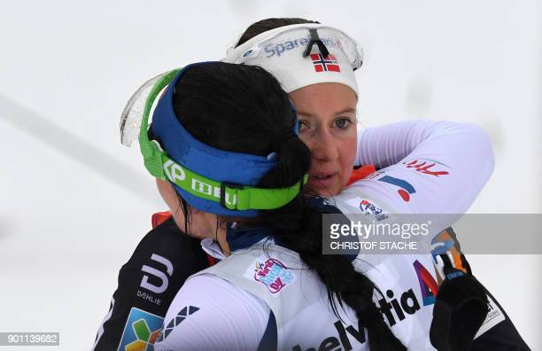 Finn Krista Parmakoski embraces Norway's Ingvild Flugstad Oestberg at the end of the ladies 10 kilometer Mass Start free style race at the 'Tour de...