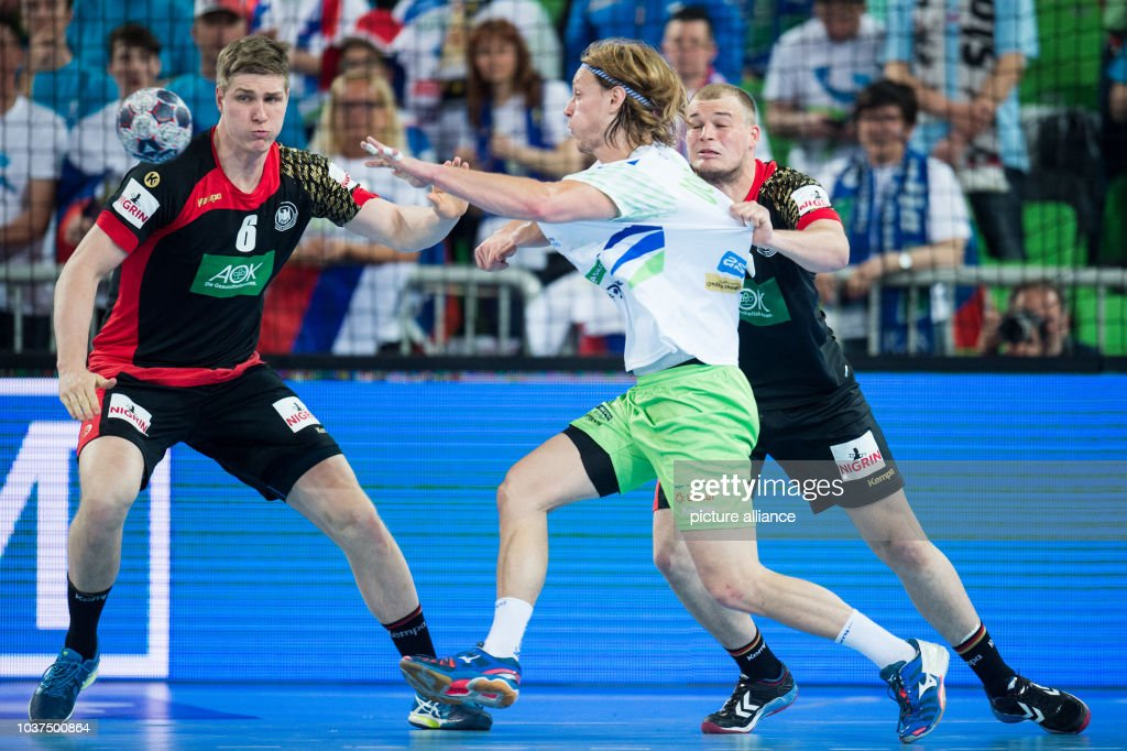 Finn Lemke And Paul Drux Of Germany In Action Against Jure